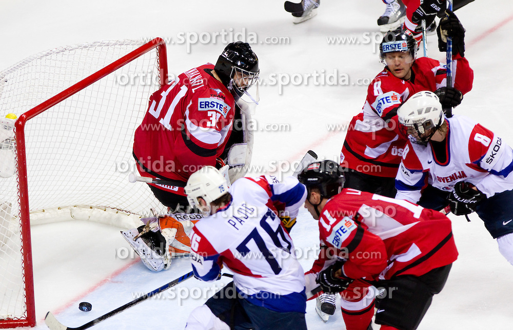 Rok Pajic of Slovenia and Ziga Jeglic of Slovenia vs Fabian Weinhandl of Austria, Philippe Lakos of Austria and Roland Kaspitz of Austria  during ice-hockey match between Austria and Slovenia of Group G in Relegation Round of IIHF 2011 World Championship Slovakia, on May 7, 2011 in Orange Arena, Bratislava, Slovakia. Austria defeated Slovenia 3-2. (Photo By Vid Ponikvar / Sportida.com)