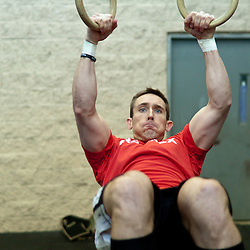 Bryan Wayne doing muscle ups at Progressive Fitness CrossFit. Crossfit image, picture, photo, photography of health, elite, exercise, training, workouts, WODs, taken at Progressive Fitness CrossFit,Colorado Springs, Colorado, USA