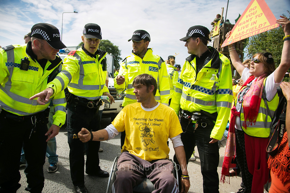 13 local activists locked themselves in specially made arm tubes to block the entrance to Quadrilla's drill site in New Preston Road, July 03 2017, Lancashire, United Kingdom. Nick Sheldrick arrested and taken to cout. The 13 activists included 3 councillors; Julie Brickles, Miranda Cox and Gina Dowding and Nick Danby, Martin Porter, Jeanette Porter,  Michelle Martin, Louise Robinson,<br /> Alana McCullough, Nick Sheldrick, Cath Robinson, Barbara Cookson, Dan Huxley-Blyth. The blockade is a repsonse to the emmidiate drilling for shale gas, fracking, by the fracking company Quadrilla. Lancashire voted against permitting fracking but was over ruled by the conservative central Government. All the activists have been active in the struggle against fracking for years but this is their first direct action of peacefull protesting. Fracking is a highly contested way of extracting gas, it is risky to extract and damaging to the environment and is banned in parts of Europe . Lancashire has in the past experienced earth quakes blamed on fracking.