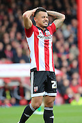 Brentford defender, Nico Yennaris (28) looking unhappy during the Sky Bet Championship match between Brentford and Bristol City at Griffin Park, London, England on 16 April 2016. Photo by Matthew Redman.