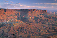 Sunset light on red rock cliffs from Green River Overlook, Island in the Sky, Canyonlands National Park, UTAH