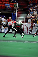 6-28-2007: Anchorage, AK - The Alaska Wilds Thomas Ford Jr.(3) battles for yards against Centex Barracuda Roderick Knight in the Alaska Wild 47 to 53 loss to the CenTex Barracudas at the Sullivan Arena...