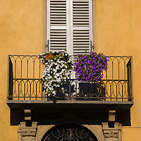 Balcony with plants on apartment building, Cherasco, Piedmont, Italy