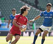 Twickenham. UK.  Canada's. Nathan HIRAYAMA, breaking oout of defence during the  Canada vs Samoa. 2015. Marriott London Sevens. RFU Twickenham Stadium. Surrey. 16.05.2015. [Mandatory Credit: Peter Spurrier/Intersport Images]