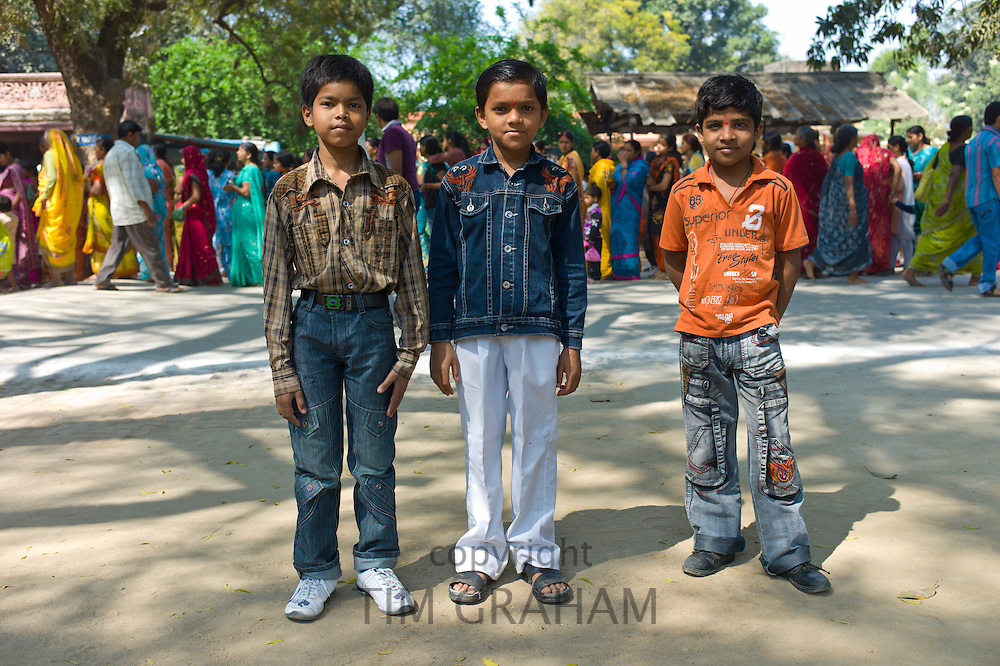 Indian boys in western clothes at Vishwanatha Temple (Birla Temple) in Festival of Shivaratri in holy city of Varanasi, India