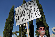 "Steve Coates was one of about 1,000 demonstrators who participated in Occupy Tucson at Military Plaza in Armory Park, Tucson, Arizona, USA.  The Occupy Tucson organizers created the movement in solidarity with the Occupy Wall Street movement in New York and the Occupy Together movement across the USA.  Coates, said, ""I am tired of the betrayal by our government of the people for the wealthy.""..The leaders of this movement are the everyday people participating in a movement with many de-centralized goals, with an over-arching theme of protesting government corruption from corporate money and national income disparity. We use a tool called the ""General Assembly"" to facilitate open, participatory and horizontal organizing between members of the public. We welcome people from all colors, genders and beliefs to participate in our movement. .."