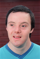 Portrait of man with Downs Syndrome,