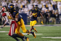 Nov 23, 2018; Morgantown, WV, USA; West Virginia Mountaineers running back Kennedy McKoy (6) runs the ball during the fourth quarter against the Oklahoma Sooners at Mountaineer Field at Milan Puskar Stadium. Mandatory Credit: Ben Queen-USA TODAY Sports