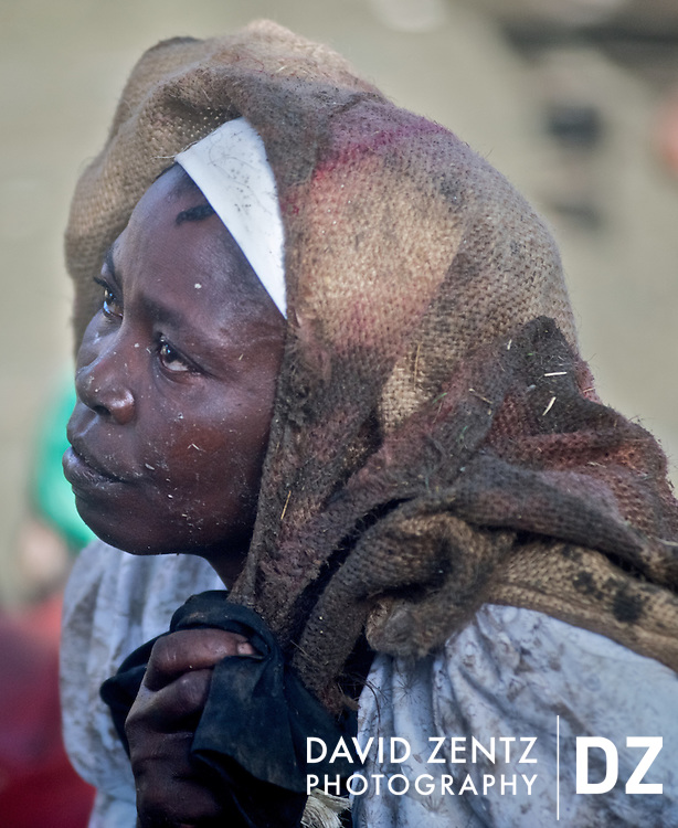 A woman dons a burlap back to atone for her sins during the Plaine du Nord voodou festival in northern Haiti on July 24, 2008.