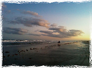 couple walking on beach at sunset,wide angle cellphone photography,Iphone pictures,smartphone pictures