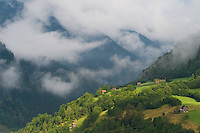 IFTE-NB-007927; Niall Benvie; Cut hay meadows near Fliess; Austria; Europe; Austria; Tirol; clouds mist hut building hay barn fields; horizontal; high above steep; green; farmland grassland meadow; 2008; July; summer; mist; agriculture; Wild Wonders of Europe Naturpark Kaunergrat