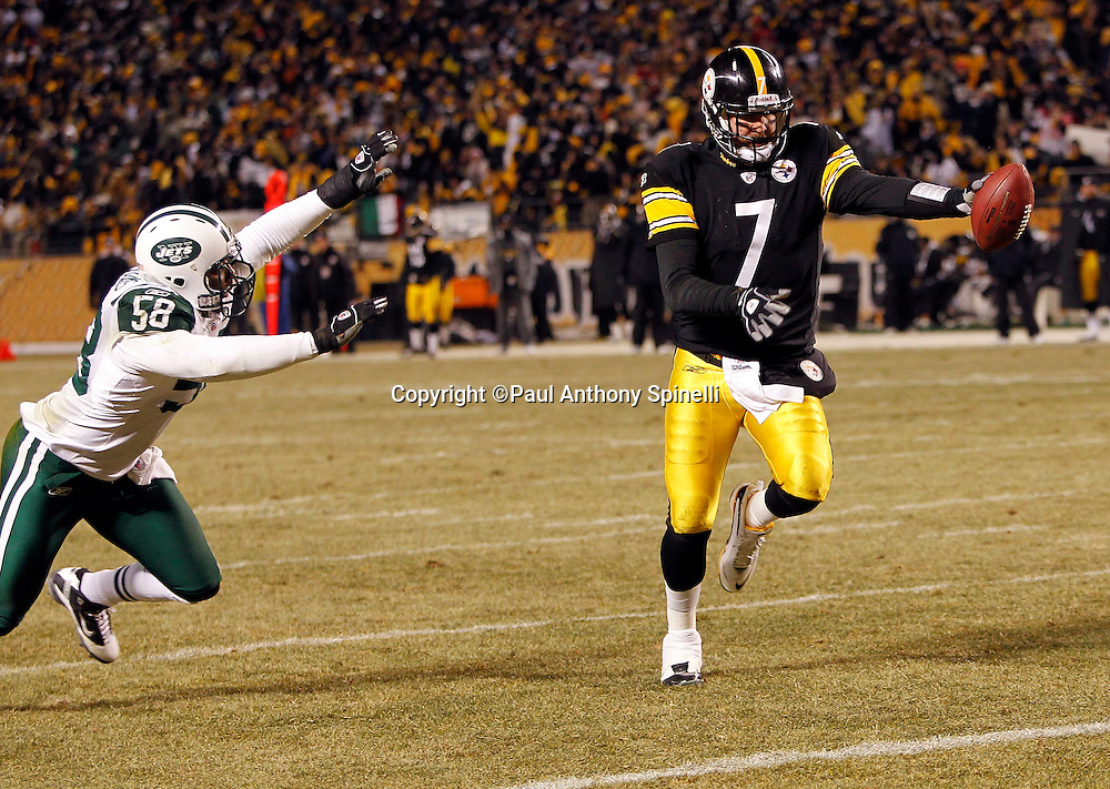 Pittsburgh Steelers quarterback Ben Roethlisberger (7) avoids the outstretched arms of New York Jets linebacker Josh Mauga (58) as he runs for a second quarter touchdown that gives the Steelers a 17-0 lead during the NFL 2011 AFC Championship playoff football game against the New York Jets on Sunday, January 23, 2011 in Pittsburgh, Pennsylvania. The Steelers won the game 24-19. (©Paul Anthony Spinelli)