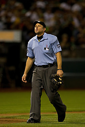 OAKLAND, CA - SEPTEMBER 23:  MLB umpire Chris Guccione #68 stands on the field during the sixth inning between the Oakland Athletics and the Los Angeles Angels of Anaheim at O.co Coliseum on September 23, 2014 in Oakland, California. The Los Angeles Angels of Anaheim defeated the Oakland Athletics 2-0.  (Photo by Jason O. Watson/Getty Images) *** Local Caption *** Chris Guccione