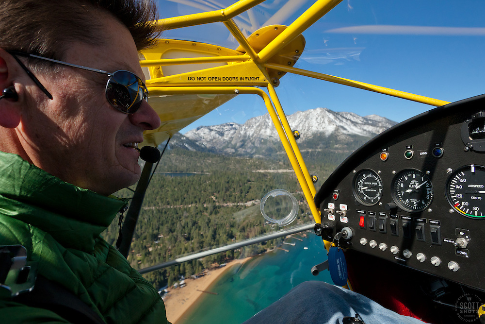 """Pilot over Lake Tahoe 1"" - This pilot was photographed flying an amphibious seaplane over Lake Tahoe, CA."