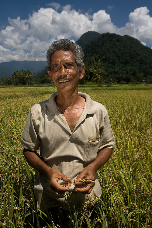 Keutapang Village near Banda Aceh - Aceh, Indonesia  Nov. 2008. (Heifer Participant) Azis the community organizer Heifer is working with. Azis used to be a sailor and has worked on ships in Germany and all over the Pacific. Aziz says it is difficult to get people involved in the Heifer project after they are used to getting immediate relief AID. But his personal conviction and leadership has made his communities program one of the most successful in the Tsunami recovery area.
