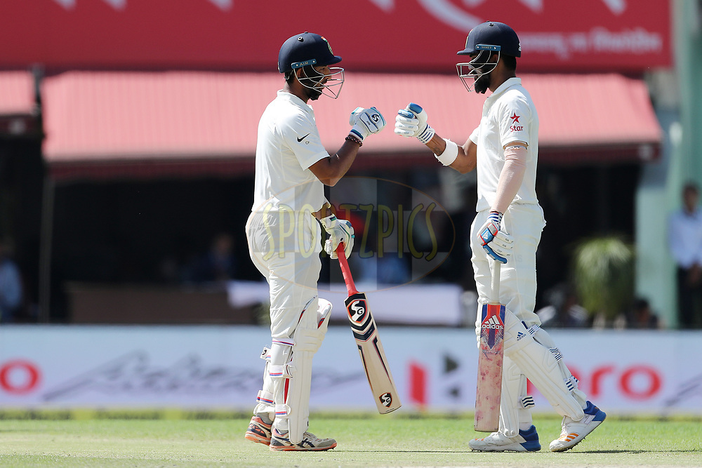 Cheteshwar Pujara of India and K Lokesh Rahul of India  during day two of the fourth test match between India and Australia held at the Himachal Pradesh Cricket Association Stadium on the 26th March 2017.<br /> <br /> Photo by: Ron Gaunt/ BCCI/ SPORTZPICS