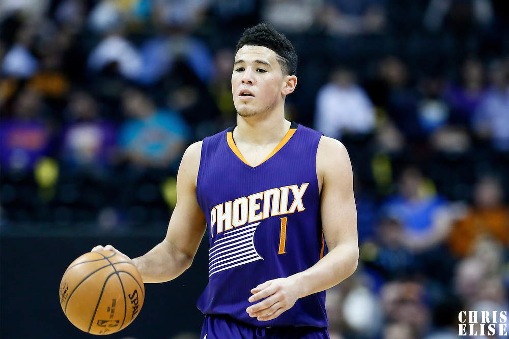 16 November 2016: Phoenix Suns guard Devin Booker (1) brings the ball up court during the Denver Nuggets 120-104 victory over the Phoenix Suns, at the Pepsi Center, Denver, Colorado, USA.
