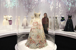 A gallery assistant looks at the Christian Dior by Maria Grazia Chiuri (b. 1964), Haute Couture, Spring/Summer 2017 'Jardin Fleuri' dress during the preview into the 'Christian Dior: Designer of Dreams' at the Victoria and Albert Museum, London. Picture dated: Wednesday January 30, 2019. Photo credit should read: Isabel Infantes / EMPICS Entertainment.