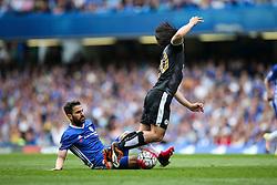 Cesc Fabregas of Chelsea tackles Shinji Okazaki of Leicester City - Mandatory byline: Jason Brown/JMP - 15/05/2016 - FOOTBALL - London, Stamford Bridge - Chelsea v Leicester City - Barclays Premier League