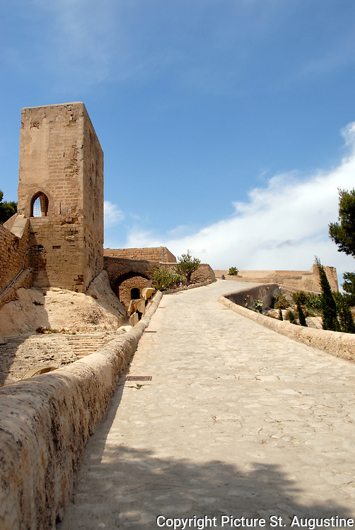 A road in the interior of Castillo de Santa Barbara in Alicante, Spain. This stone paved road leads up the hill and seems to go on forever. The Castle Santa Barbara is located on Mount Benacantil which rises 166 meters above sea level.