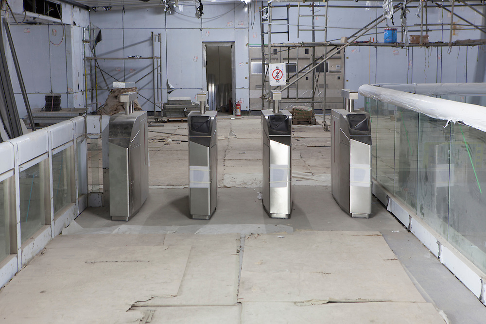 Ticket barriers installed inside an under construction subway station on the Xinyo line.