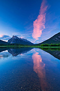 Cloud at dawn reflected in Vermillion Lakes with Mtount Rundle and Sulphur Mountain.<br />