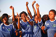 Makhnda U17 girls football club celebrate a winning goal. Khubvi Village. Nr Thohoyandou. Venda. Limpopo Province. South Africa. .Action Aid..Pictures by Zute & Demelza Lightfoot. www.lightfootphoto.com zutelightfoot@yahoo.co.uk +27(0)715957308..