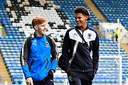Alfie Egan (28) of AFC Wimbledon and Toby Sibbick (20) of AFC Wimbledon arrive at Fratton Park before the EFL Sky Bet League 1 match between Portsmouth and AFC Wimbledon at Fratton Park, Portsmouth, England on 26 December 2017. Photo by Graham Hunt.
