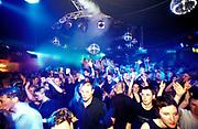 A crowded dancefloor at a nightclub in London, U.K, 1990s