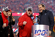 Kansas City Chiefs owner Clark Hunt, left, and head coach Andy Reid, center, celebrate winning the NFL AFC Championship football game against the Tennessee Titans, Sunday, Jan. 19, 2020, in Kansas City, MO. The Chiefs won 35-24 to advance to Super Bowl 54. Photo by Colin Eric Braley Photography