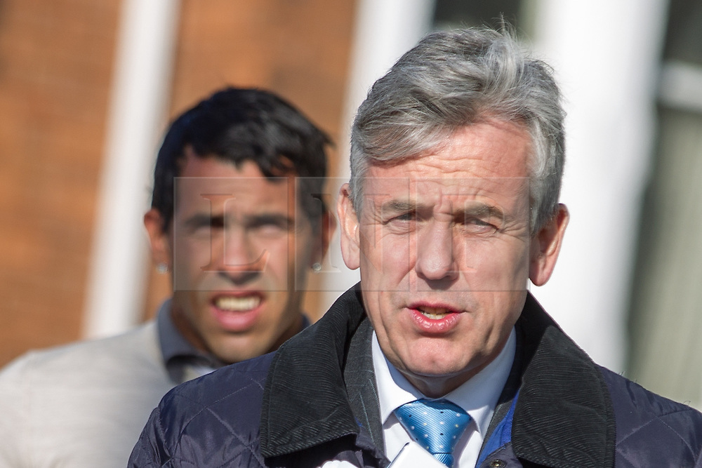 © Licensed to London News Pictures . 03/04/2013 . Macclesfield , UK . Manchester City footballer , Carlos Tevez (left) and solicitor Gwyn Lewis (aka Merlin the Magician by other Manchester City players he's represented) (right) , arrive at Macclesfield Magistrates Court today (3rd April) . Tevez is charged with breaching a driving ban after being arrested on 8th March 2013 on the A538 in Macclesfield . Photo credit : Joel Goodman/LNP