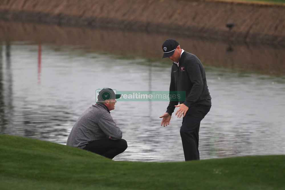 February 3, 2019 - Scottsdale, AZ, U.S. - SCOTTSDALE, AZ - FEBRUARY 03: Jason Kokrak and Trey Mullinax discuss the lie of Mullinax's shot on the 18th hole. A PGA official was called in to resolve the situation at the final round of the Waste Management Phoenix Open on February 3, 2019, at TPC Scottsdale in Scottsdale, Arizona.  (Photo by Will Powers/Icon Sportswire) (Credit Image: © Will Powers/Icon SMI via ZUMA Press)