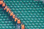 Security staff sit on the tribune during T-Mobile ExtraLeague soccer match between Legia Warsaw and Wisla Krakow in Warsaw, Poland.<br /> <br /> Poland, Warsaw, March 15, 2015<br /> <br /> Picture also available in RAW (NEF) or TIFF format on special request.<br /> <br /> For editorial use only. Any commercial or promotional use requires permission.<br /> <br /> Mandatory credit:<br /> Photo by © Adam Nurkiewicz / Mediasport