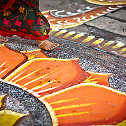 A woman walk in front of a Hindu temple in Little India, Penang, Malaysia.