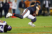 Chicago Bears tight end Zach Miller (86) goes airborne as he gets tackled by Minnesota Vikings middle linebacker Eric Kendricks (54) as he catches a pass good for a gain of 17 yards and a first down on a third down play during the 2016 NFL week 8 regular season football game against the Minnesota Vikings on Monday, Oct. 31, 2016 in Chicago. The Bears won the game 20-10. (©Paul Anthony Spinelli)