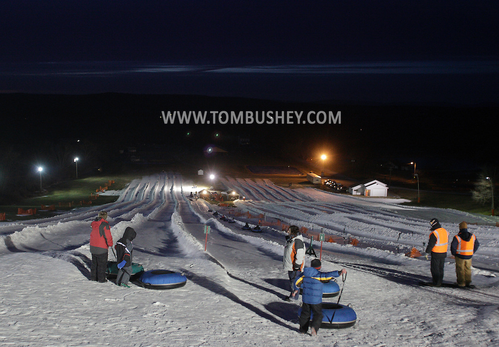 Hamptonburgh, NY - People get ready to snow tube down a hill at Thomas Bull Park on the evening of on Jan. 30, 2010.