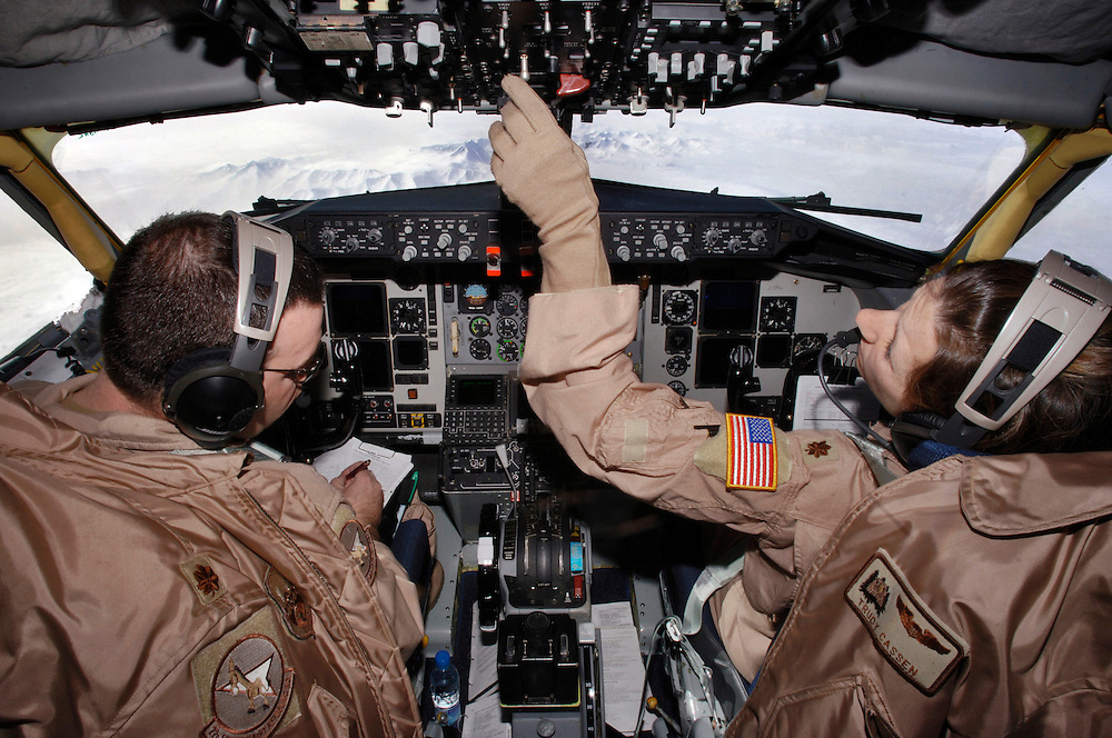 Majors Daniel Arch (left), and Trudy Cassen, instructor pilots, fly a KC-135T/R Stratotanker during an aerial refueling mission in Southwest Asia. The flight crew will take the tanker to a speed greater than 250 knots and deliver more than 40,000 pounds of fuel to a RC-135 Rivet Joint reconnaissance aircraft. This will allow it to remain on station or move on to other stations to perform its airborne mission. The tanker and crew are deployed to the 22nd Expeditionary Air Refueling Squadron, Manas Air Base, Kyrgyz Republic, from the 92nd Air Refueling Squadron, Fairchild Air Force Base, Wash. Major Arch and Cassen are natives of Hackettstown, NJ. and Clevland, Ohio. (U.S. Air Force photo by Master Sgt. Lance Cheung)<br />
