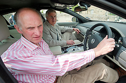 Hatfields Jaguar Ride and Drive event at the Cavendish Hotel Baslow Derbyshire.Former blue peter presenter Simon Groom and Camera man David Scott prepare for a drive in one of Hatfields Jaguars...5th May 2011.Images © Paul David Drabble