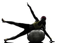 one woman exercising fitness workout on fitness ball in silhouette on white background