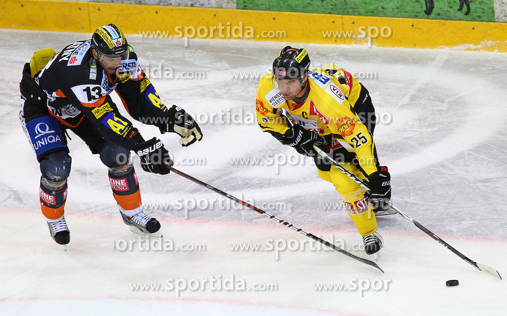 22.01.2012, Albert Schultz Halle, Wien, AUT, EBEL, UPC Vienna Capitals vs Moser Medical Graz 99ers, im Bild Zdenek Blatny, (Moser Medical Graz 99ers, #13) und Benoit Gratton, (UPC Vienna Capitals, #25)  // during the icehockey match of EBEL between UPC Vienna Capitals (AUT) and Moser Medical Graz 99ers (AUT) at Albert Schultz Halle, Vienna, Austria on 22/01/2012,  EXPA Pictures © 2012, PhotoCredit: EXPA/ T. Haumer