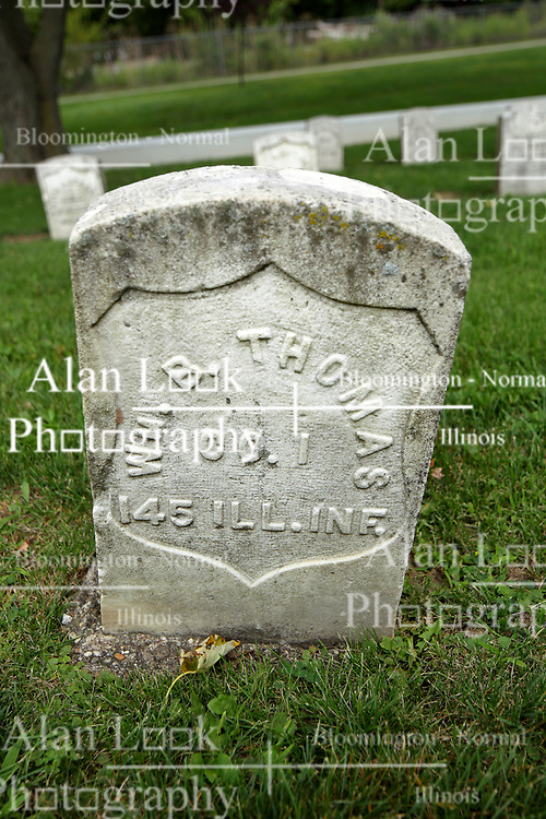 26 August 2017:   A part of the History of McLean County Illinois.<br /> <br /> Tombstones in Evergreen Memorial Cemetery.  Civic leaders, soldiers, and other prominent people are featured. Section 5, the old town soldiers area<br /> WM. B. Thomas  Co I  145 ILL INF