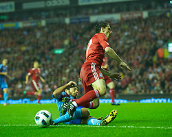 LIVERPOOL, ENGLAND - Thursday, August 19, 2010: Liverpool's Maximiliano Ruben Maxi Rodriguez is tackled by Trabzonspor's Egemen Korkmaz during the UEFA Europa League Play-Off 1st Leg match at Anfield. (Pic by: David Rawcliffe/Propaganda)