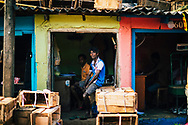 Men at their small shop at the wholesale market in downtown Colombo, Sri Lanka, Asia