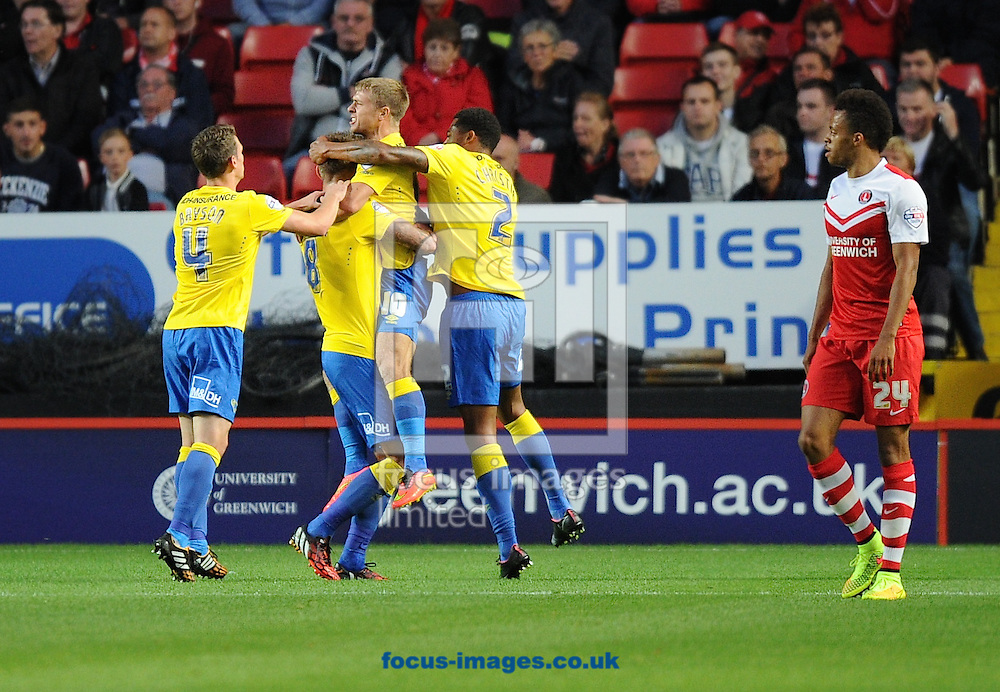Jamie Ward of Derby County (10) celebrates scoring the equaliser with Jeff Hendrick (8) Craig Bryson (4) and Cyrus Christie (2) while Jordan Cousins of Charlton Athletic  looks on  during the Sky Bet Championship match at The Valley, London<br /> Picture by Alan Stanford/Focus Images Ltd +44 7915 056117<br /> 19/08/2014