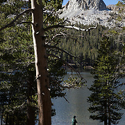 The Fall season in the Eastern Sierras is one of the most beautiful seasons to visit. Lakes are full, Aspens are glowing with colors and cooler temperatures keep the crowds to a minimum. A man fishing by himself on Lake Mary.