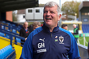 AFC Wimbledon manager Glyn Hodges laughing during the EFL Sky Bet League 1 match between AFC Wimbledon and Lincoln City at the Cherry Red Records Stadium, Kingston, England on 2 November 2019.