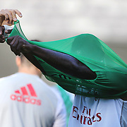Mario Balotelli, struggling with his playing bib during training with AC Milan in preparation for the Guinness International Champions Cup tie with Chelsea at MetLife Stadium, East Rutherford, New Jersey, USA.  3rd August 2013. Photo Tim Clayton