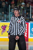 KELOWNA, CANADA - OCTOBER 4:  Kevin Crowell, linesman, stands at centre ice at the Kelowna Rockets on October 4, 2013 at Prospera Place in Kelowna, British Columbia, Canada (Photo by Marissa Baecker/Shoot the Breeze) *** Local Caption ***