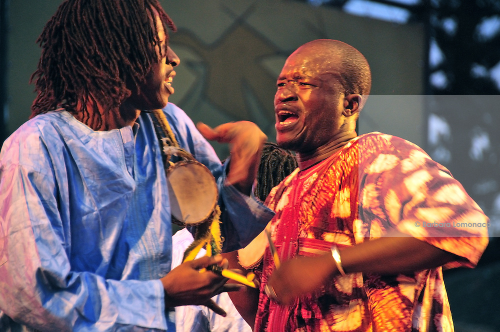 Djimi Sissoko plays the talking drum during the Gnawa Festival in Essaouira, Morocco 2011