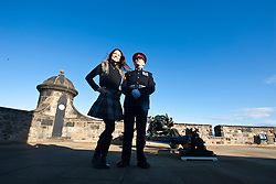 Miss Scotland Jennifer Reochs at the firing of the One O'clock gun by Gunner Jamie Shannon..The Miss World participants visit Edinburgh Castle and will witness the firing of the One O'clock gun..MISS WORLD 2011 VISITS SCOTLAND..Pic © Michael Schofield.